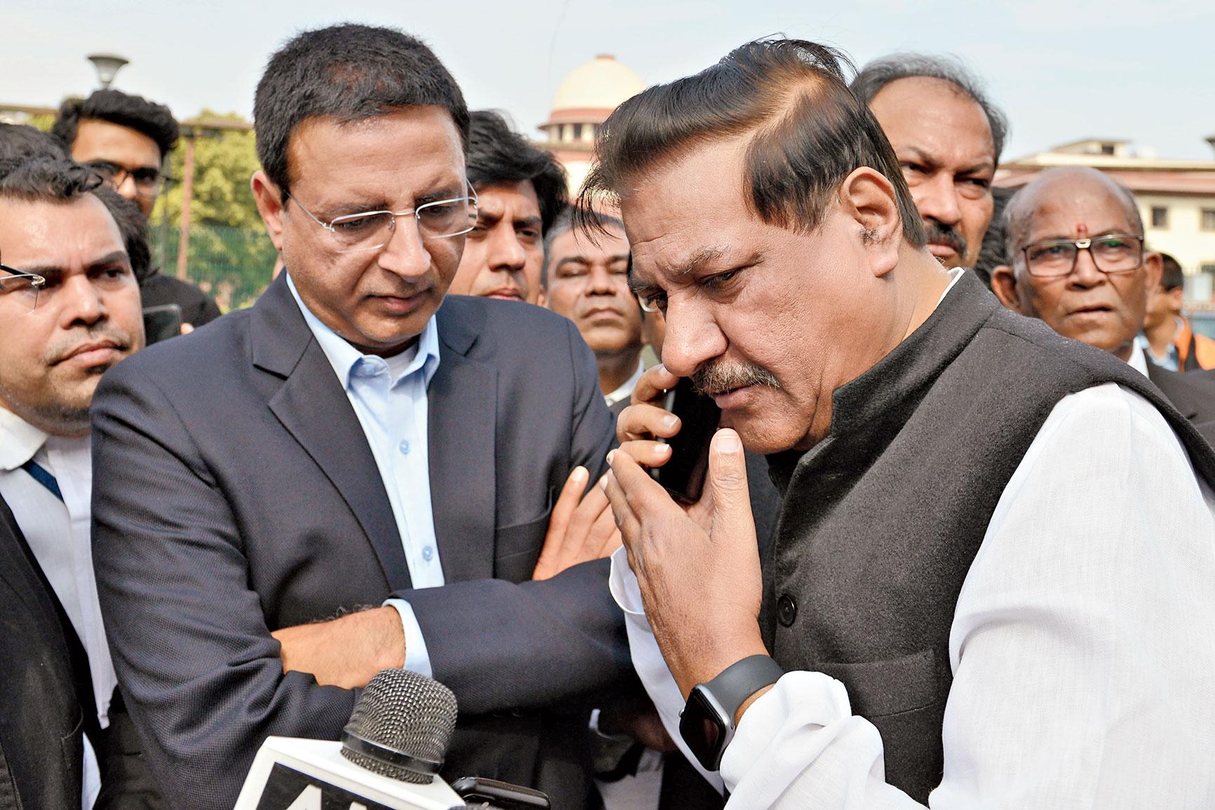 Congress leaders Randeep Surjewala and Prithviraj Chavan outside the Supreme Court on Sunday.
