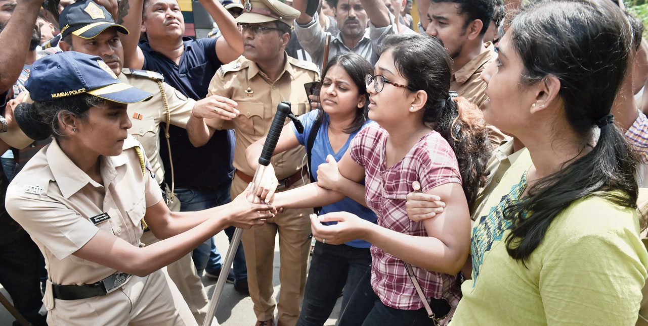 Police detain activists protesting against the felling of trees at Aarey Colony in Mumbai on Saturday.
