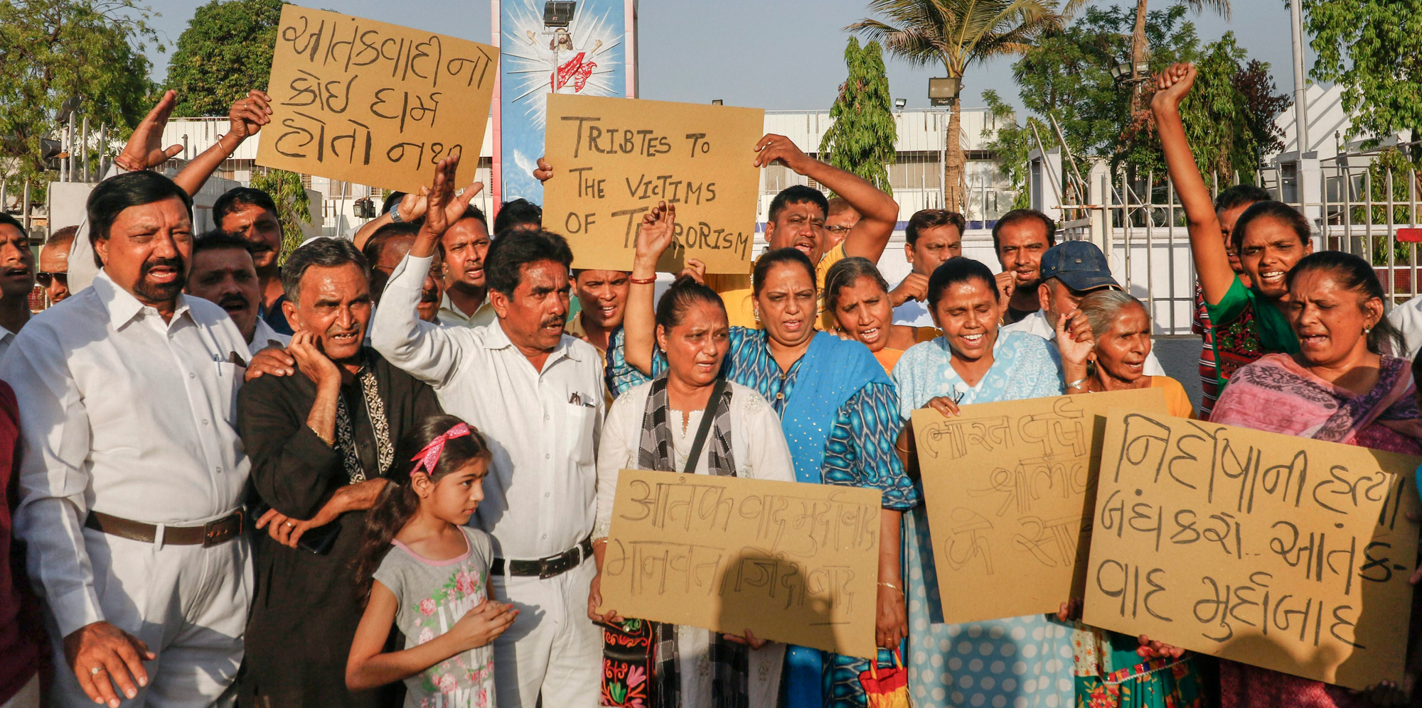 Members of Christian community hold placard to condem the bomb blasts in Sri Lanka outside the Methodist church, in Ahmedabad on Sunday, April 21, 2019.