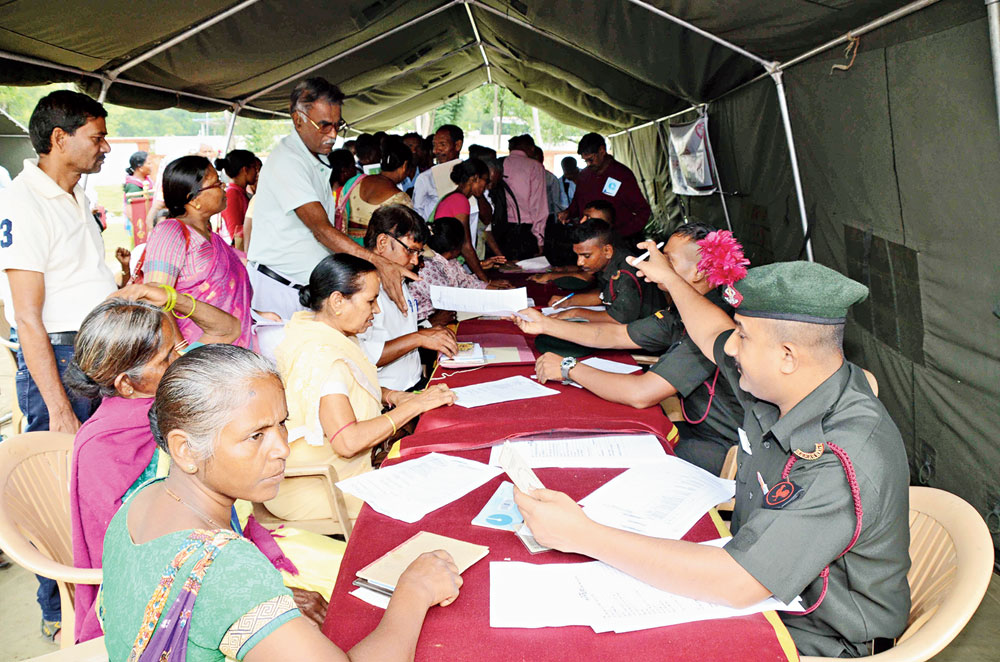 Ex-armymen and widows attend the pension camp at Dipatoli Cantonment in Ranchi on Thursday.