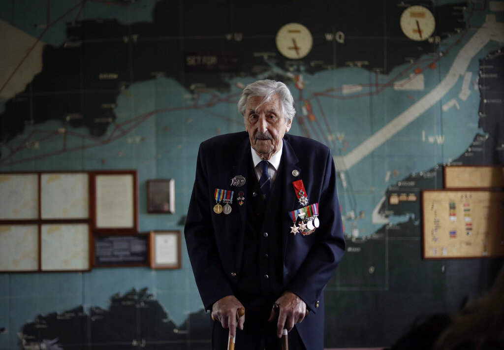 British D-Day veteran Leonard 'Ted' Emmings, who was a naval Coxswain serving on a small landing craft which landed 36 Canadians on Juno beach in France, poses for photographs backdropped by the map used to plan the Normandy D-Day landings at Southwick House near Portsmouth, England. Southwick House was the forward headquarters of the allied forces preparing for the invasion of Normandy in 1944, the nerve centre of D-Day.