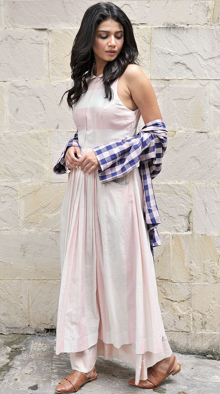 """Sauraseni picked this pink-and-blue outfit from Tahweave — a halter-neck double-layered dress in cotton with a wrap over-layer. """"I love everything by Tahweave and all their ensembles fit me so well,"""" said the Byomkesh Gowtro actress"""