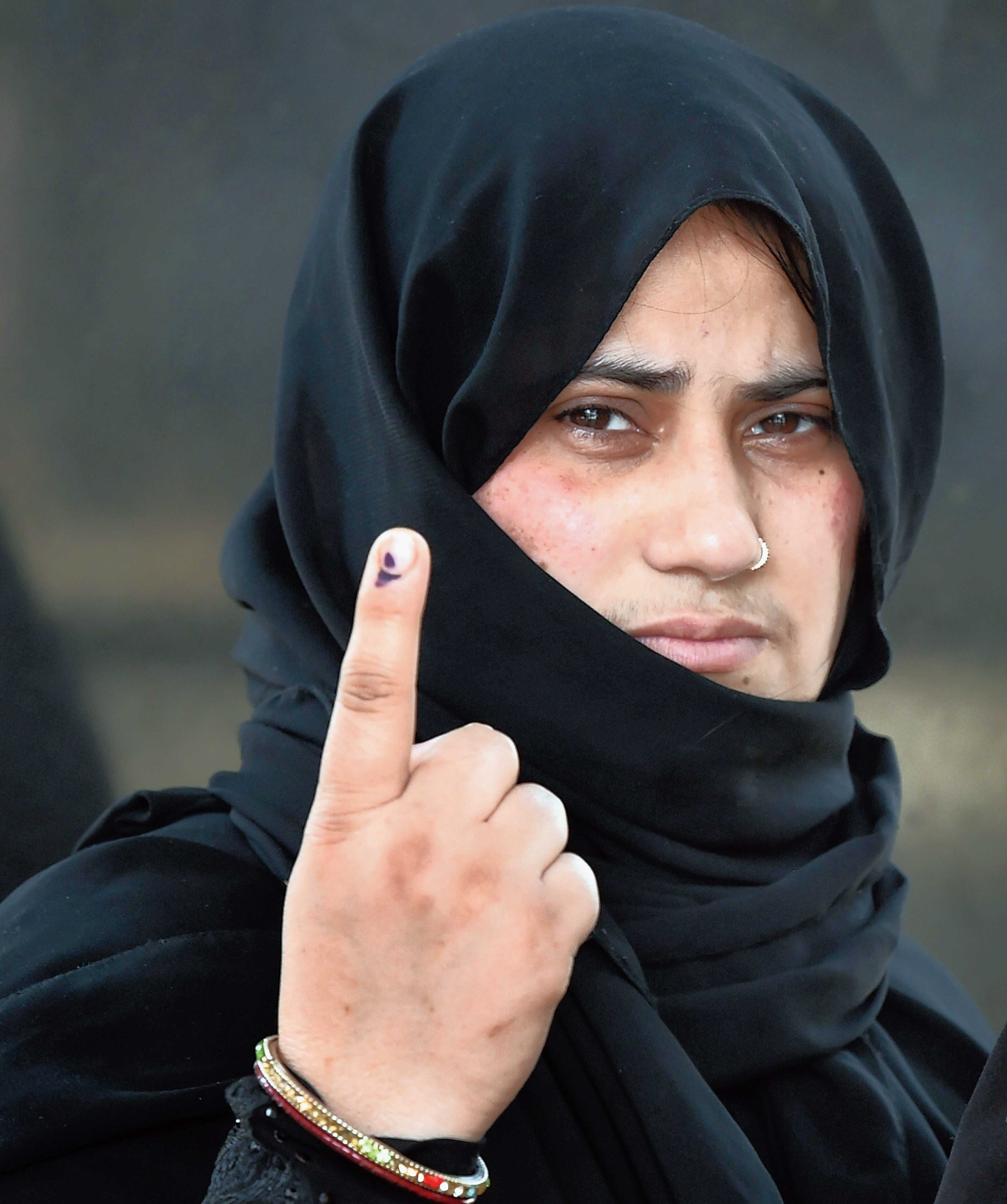 A woman in Dadri, Uttar Pradesh, shows her ink-marked finger at a polling station. Dadri is part of Gautam Buddh Nagar constituency.