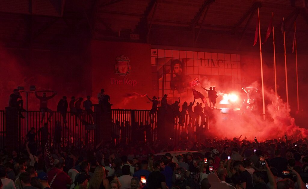 Supporters celebrate at Anfield Stadium after Liverpool clinched the English Premier League title.
