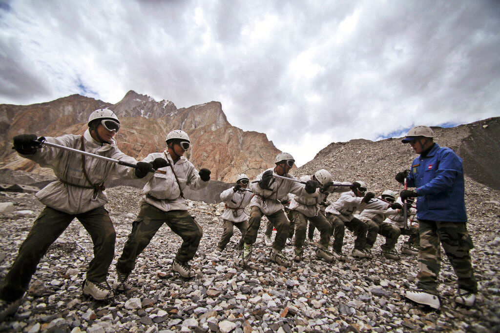 In this July 19, 2011, file photo, Indian Army soldiers undergo a training session at the Siachen base camp, in Indian Kashmir on the border with Pakistan.