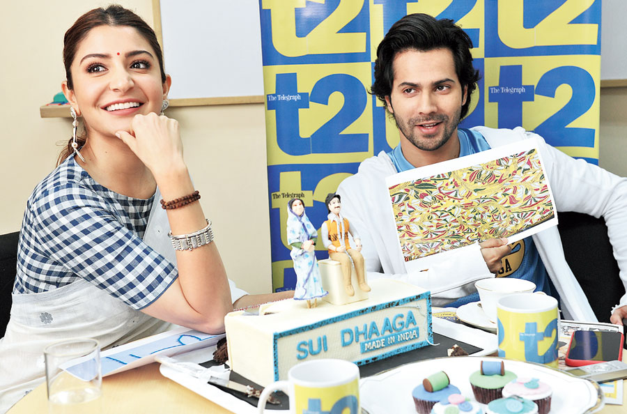 Varun Dhawan and Anushka Sharma try to figure out the stitch pattern