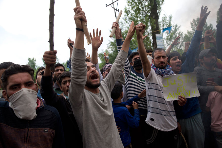 Protesters shout slogans against the alleged rape of a three-year-old girl at Mirgund on Monday