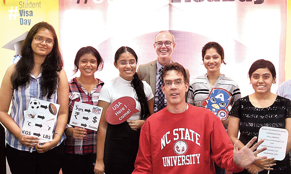 Jamie Dragon (in red sweatshirt), American Center director, poses with students at the American Center in Calcutta on Wednesday