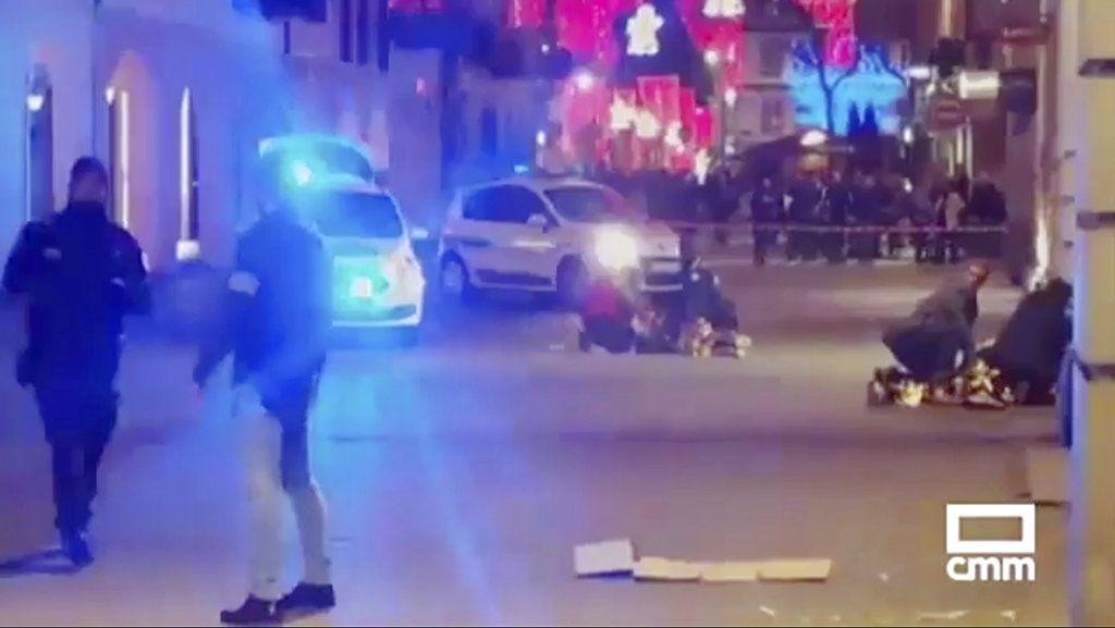 In this image made from video,, people lay on the ground after the shooting.