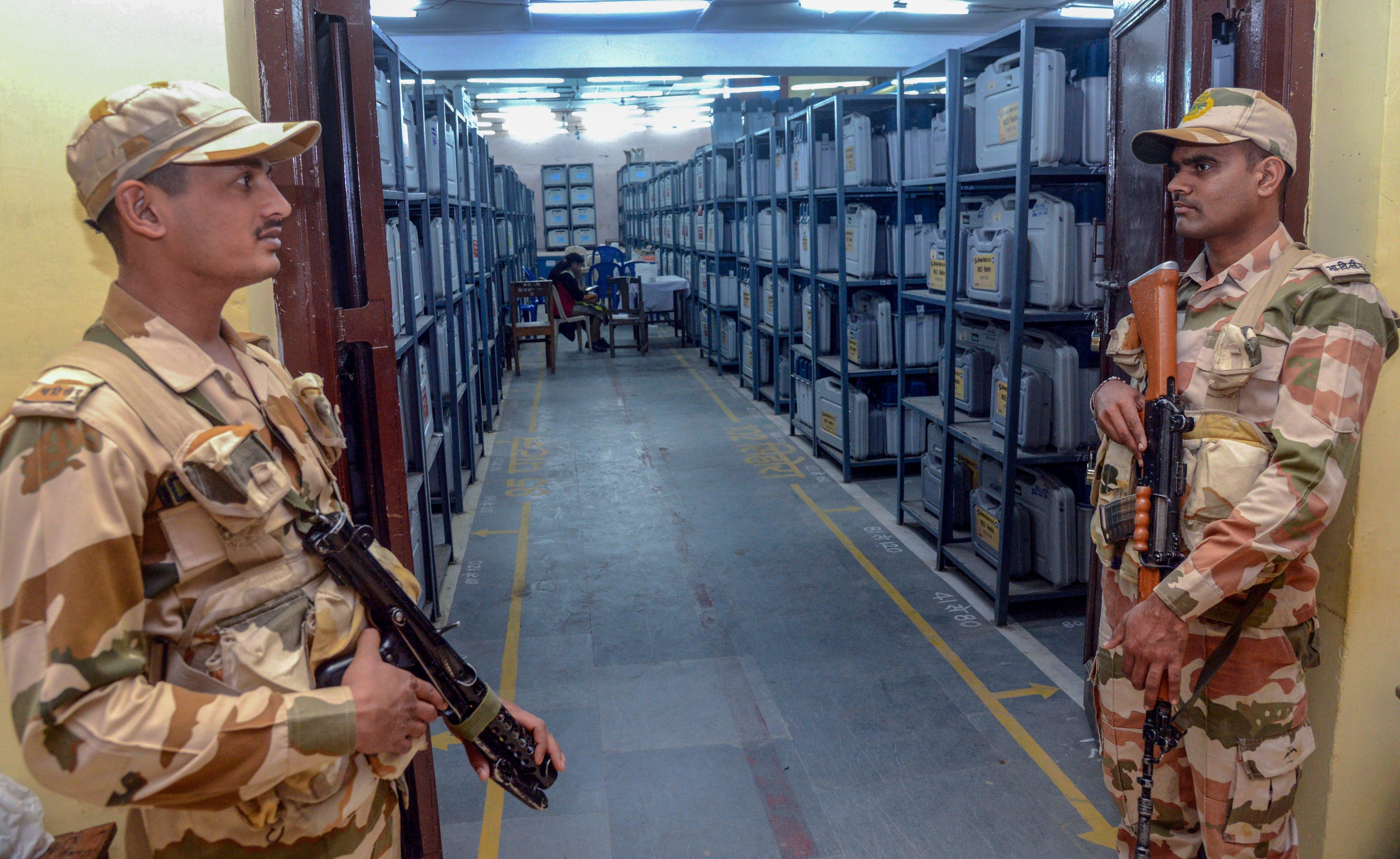 Indo-Tibetan Border Police guards keep an eye on EVMs in Jabalpur, Madhya Pradesh. The state votes on November 28