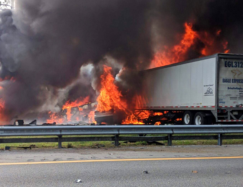 Flames engulf vehicles after a fiery crash along Interstate 75 on Thursday.