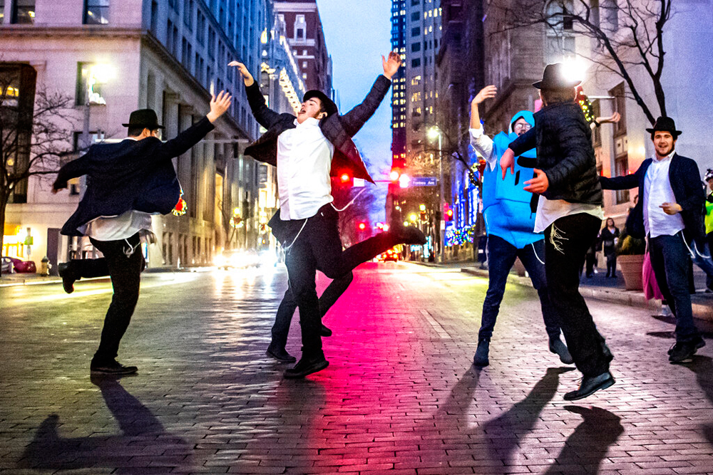 Students dance on December 26 in downtown Pittsburgh