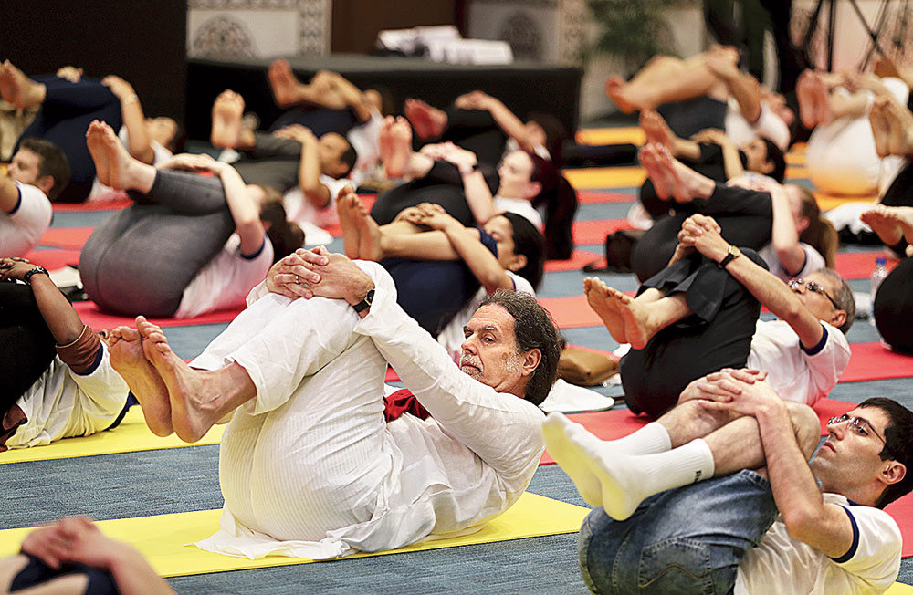 Lindner (in white) performs yoga along with other diplomats to mark International Yoga Day in New Delhi on June 21