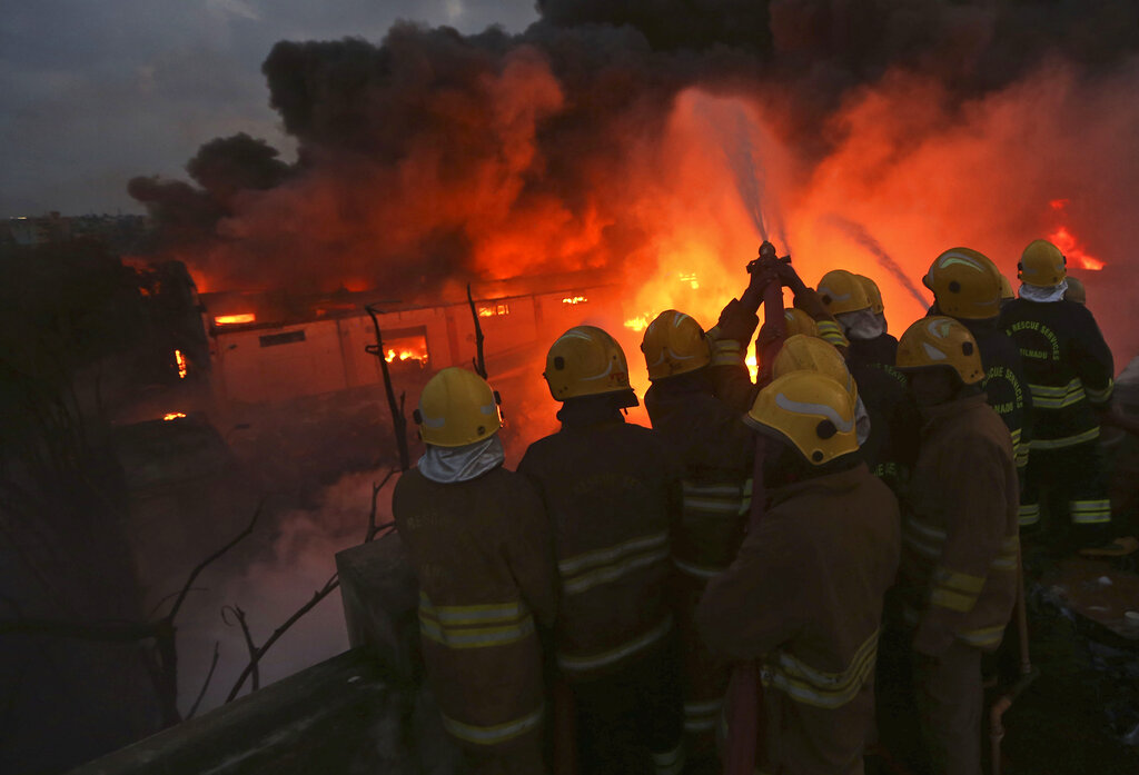 Firefighters work to control a fire at a chemical factory in Chennai, on Saturday