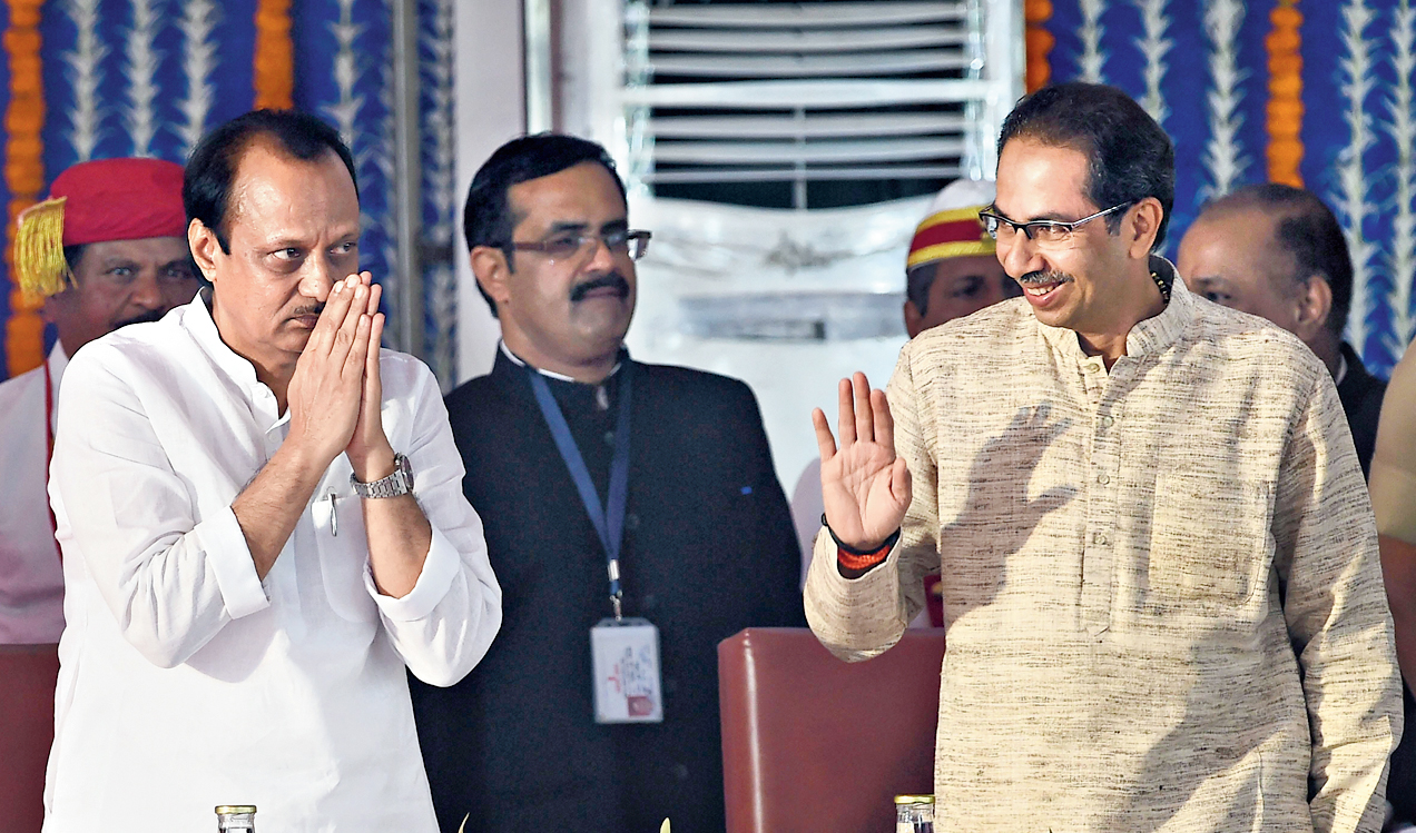 Pawar (left) and Thackeray at the swearing-in.
