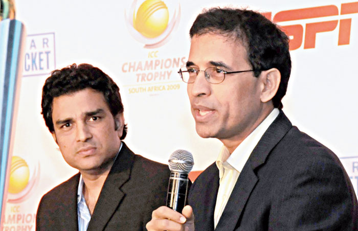 Former cricketer Sanjay Manjrekar and commentator Harsha Bhogle at the unveiling of ICC Champions Trophy in New Delhi