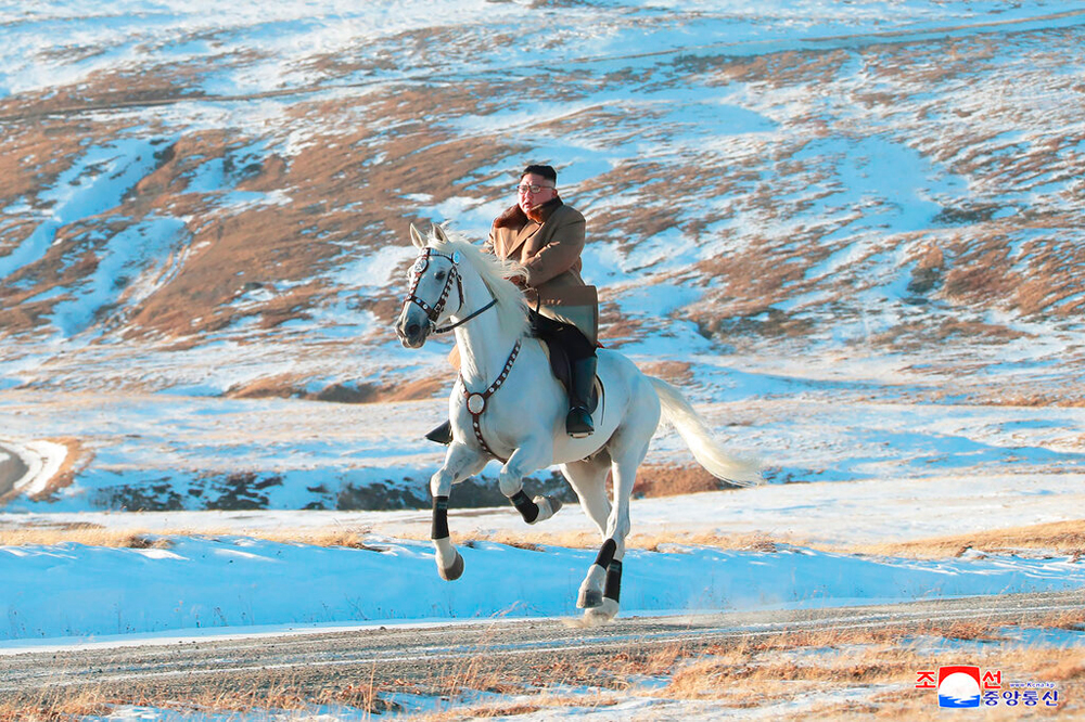 North Korean leader Kim Jong Un rides a white horse to climb Mount Paektu, a peak in the country