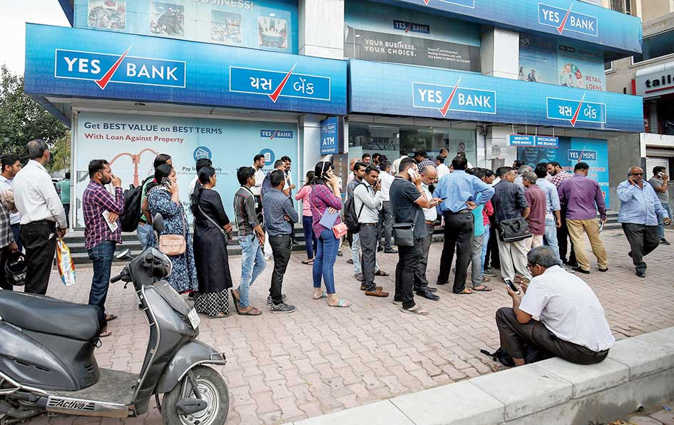 Depositors enter a Yes Bank branch in Calcutta on Tuesday.