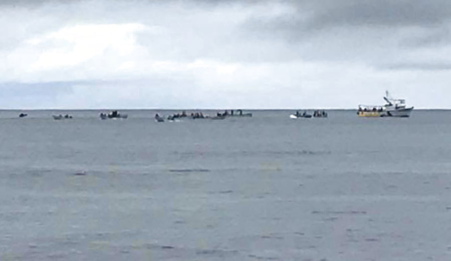 Boats at the crash site checking the fuselage of the Air Niugini plane