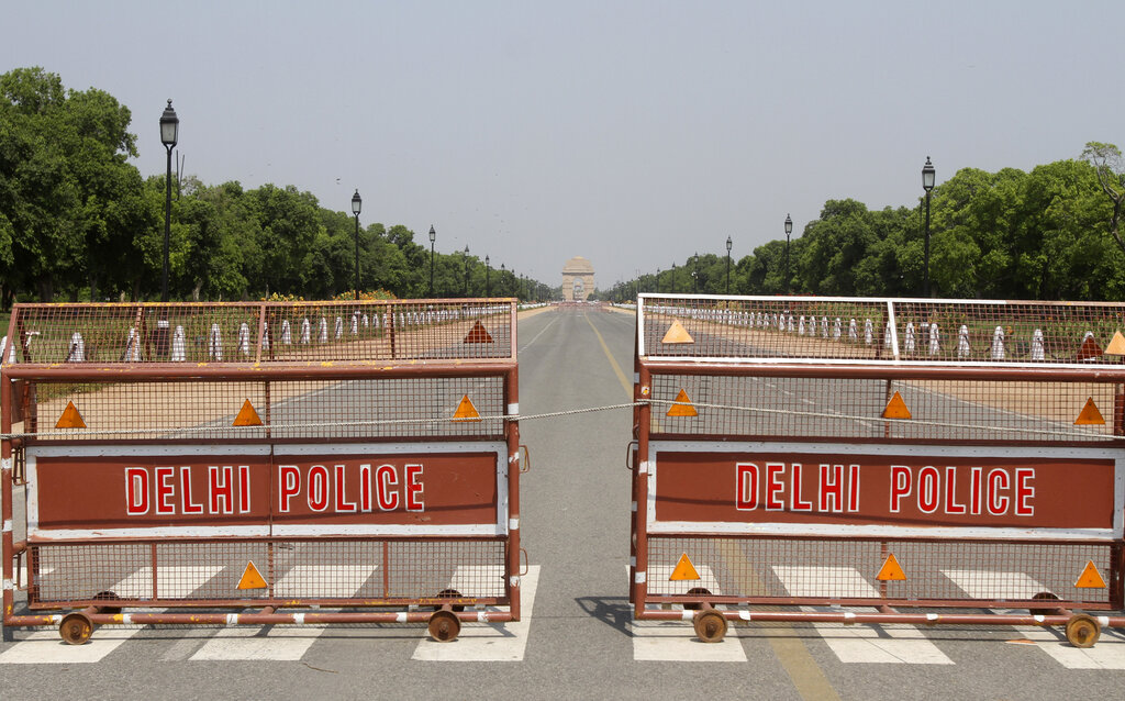 A police barricade stands on a road leading to the landmark India Gate during lockdown to prevent the spread of the new coronavirus in New Delhi, India, Friday, May 8, 2020.