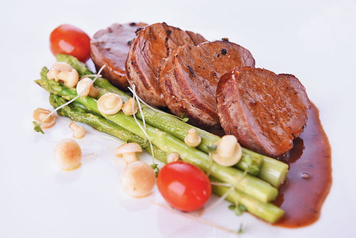 Classic Tenderloin Steak served with Thai asparagus and jus.