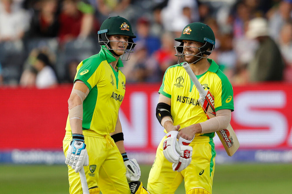 Steve Smith, left, and David Warner chat during the match on Saturday
