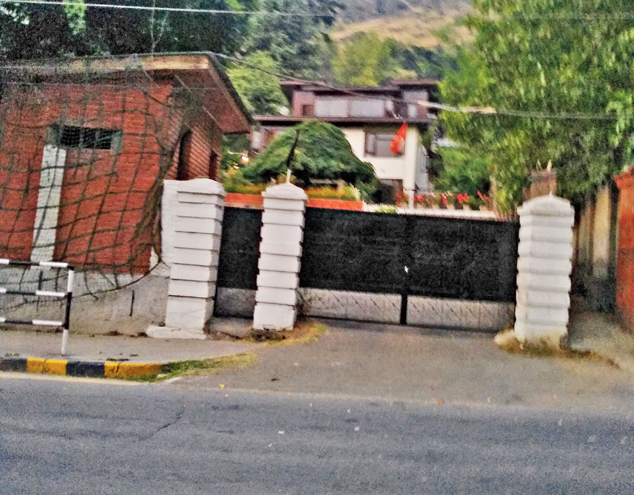 The black flag Farooq's daughter Safiya hoisted atop the gate of her house