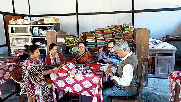 Amalendu Bhattacharjee and scholars look through the manuscripts.