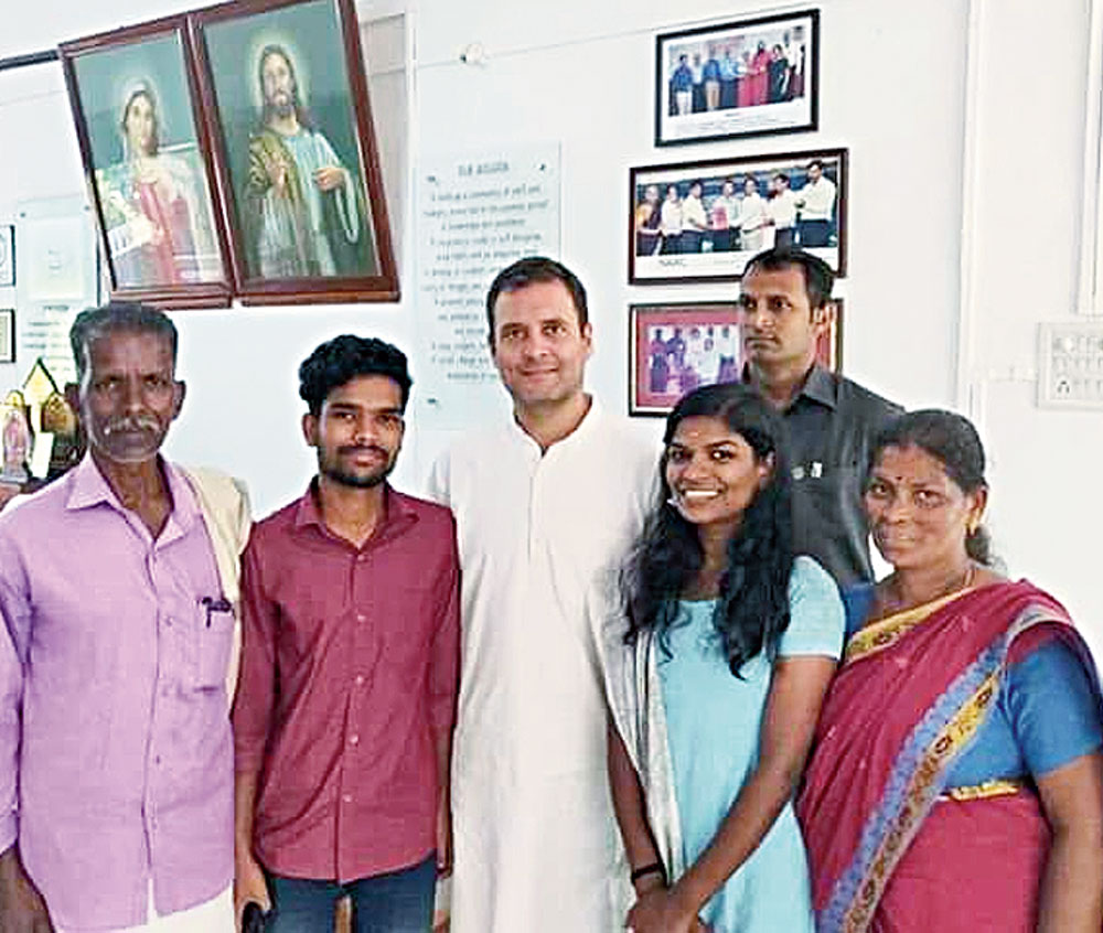 Rahul Gandhi with Sreedhanya Suresh (second from right), her brother Sreeraj Suresh, father Suresh KK and mother Kamala KC at St Mary's College in Sulthan Bathery in Wayanad, Kerala, on Wednesday