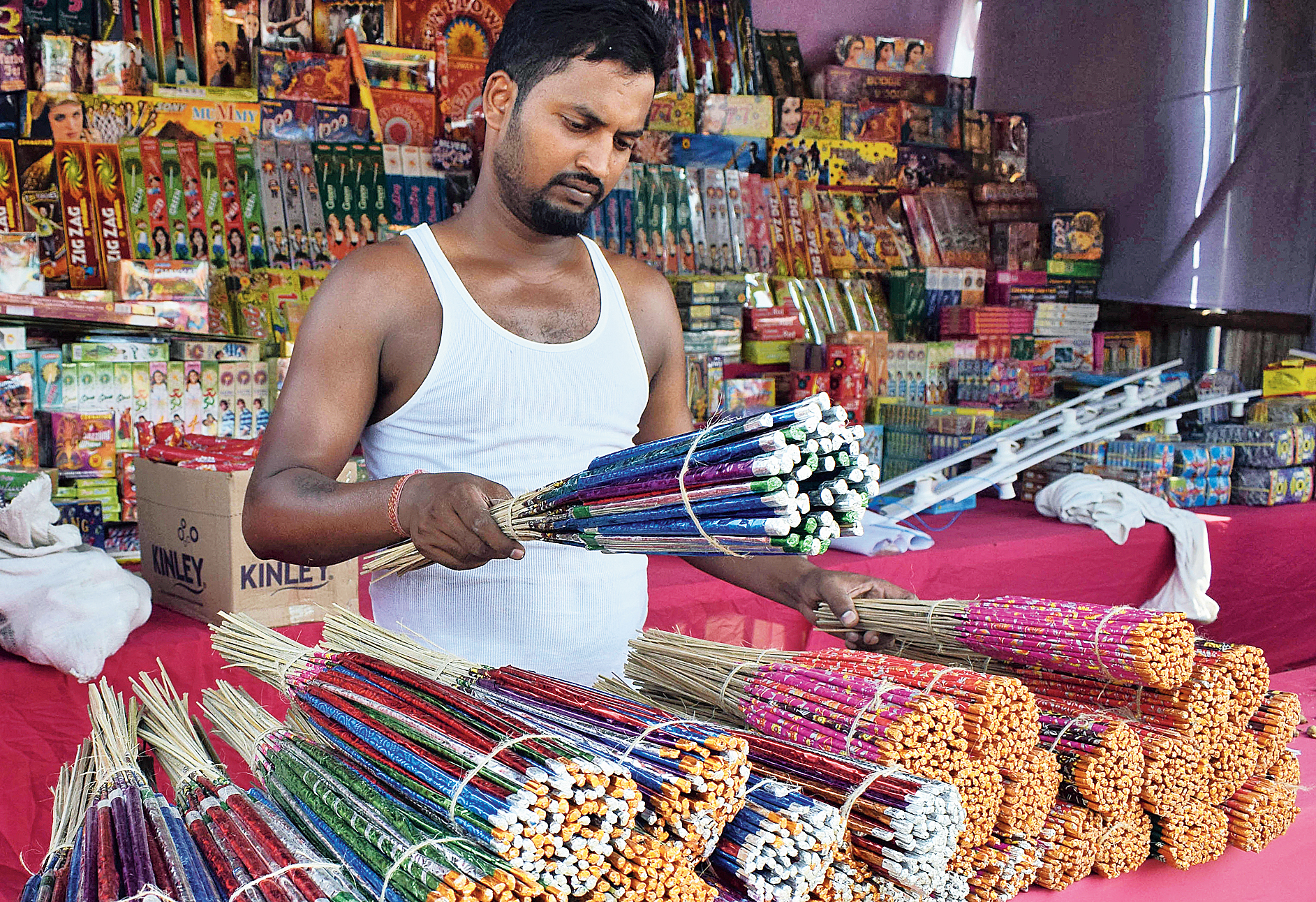 A man sells crackers at a shop in Bhubaneswar on Friday.