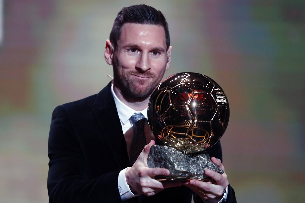 Barcelona's Lionel Messi holds the trophy of the Golden Ball award ceremony in Paris, Monday, December 2, 2019