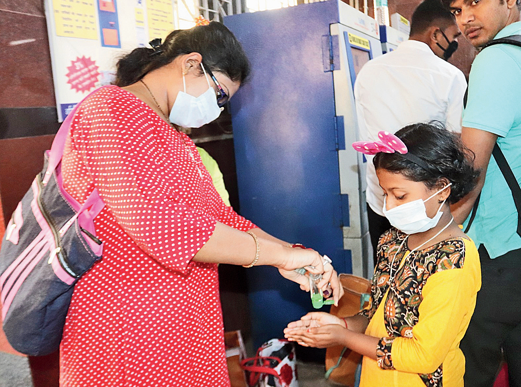 A girl being given hand sanitiser at the Burdwan railway station on Wednesday.