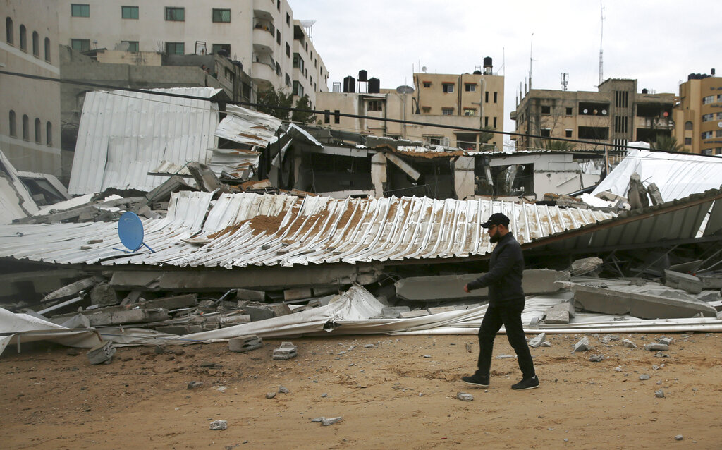 A Palestinian inspects the damage to a building that belongs to the Hamas ministry of prisoners, which was hit by Israeli airstrikes in Gaza City, early on Friday.