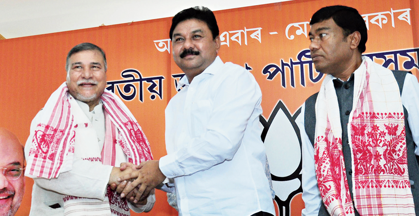 BJP leader Bhubaneswar Kalita, party state unit president Ranjeet Kumar Dass, and Union minister Rameswar Teli in Guwahati on Sunday.