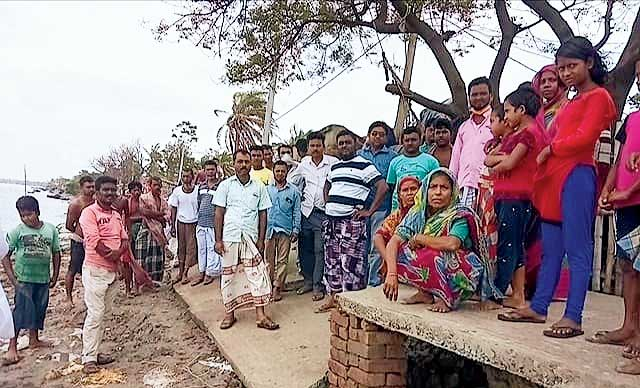 Villagers gathered on the bank of the Ichhamati river on Monday after the devastation.