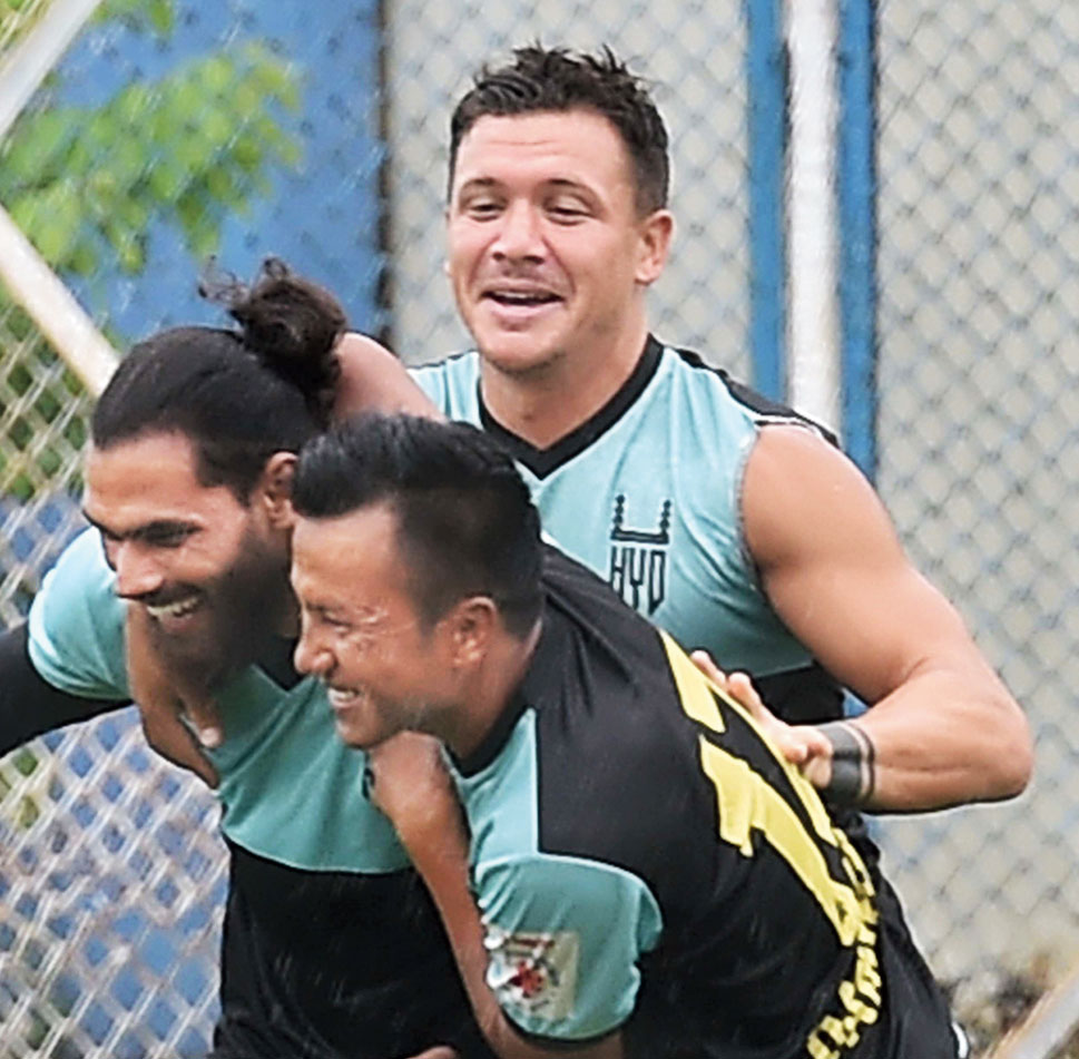 Laldanmawia Ralte of Hyderabad FC shares a light moment with Adil Khan (left) as Marko Stankovic looks on during a practice session on Thursday.