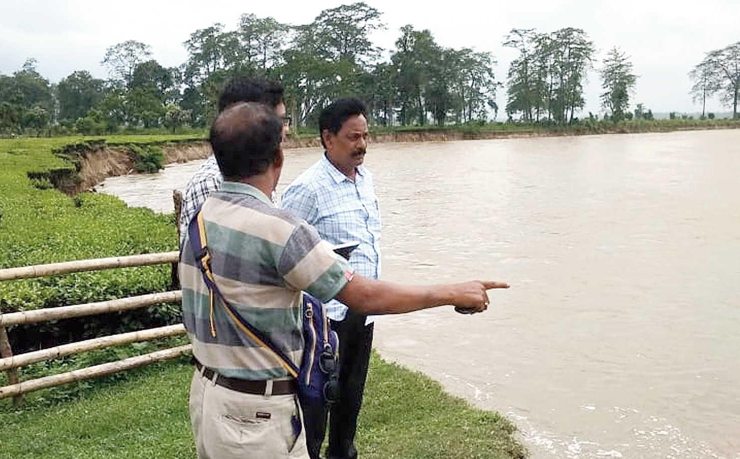Officials inspect the swelling Burai river at Gosala in Gohpur, Biswanath district, on Thursday.