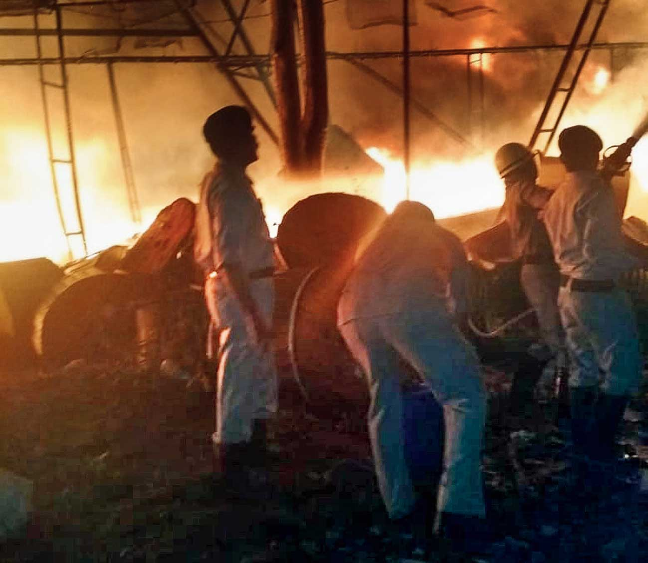 Firemen try to douse the flames at the BSNL mobile tower near Ormanjhi, Ranchi, on Saturday.