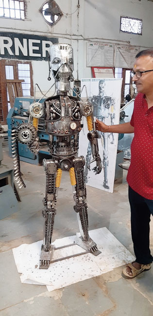 The Terminator model made of scrap from discarded vehicles.