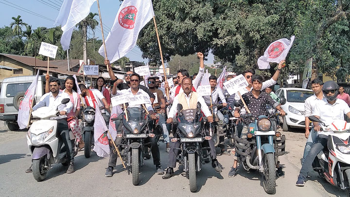 AASU activists take out the bike rally at Tangla town in Udalguri district on Monday
