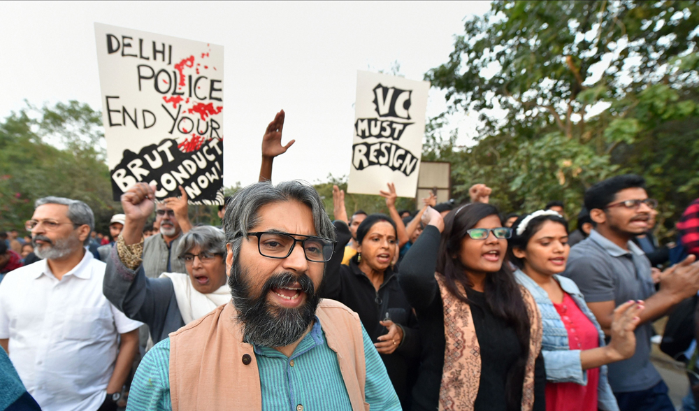 JNU teachers shout slogans during a protest on the varsity campus in New Delhi on Tuesday