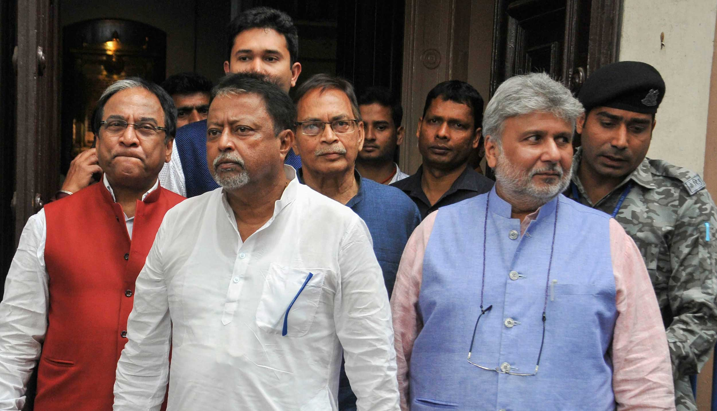 Mukul Roy (centre) with BJP leaders after a meeting with Sudeep Jain ahead of the Lok Sabha elections in Calcutta on Saturday.