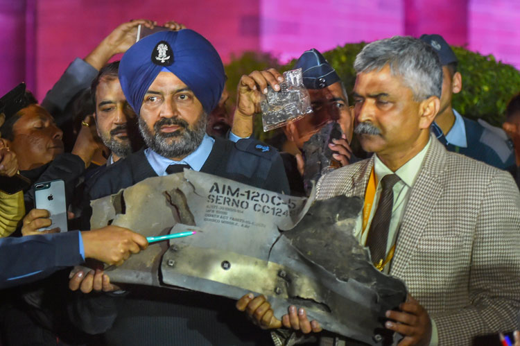 Indian Air Force officials in New Delhi on Thursday, February 28, show sections of an exploded Amraam missile said to be fired by Pakistan