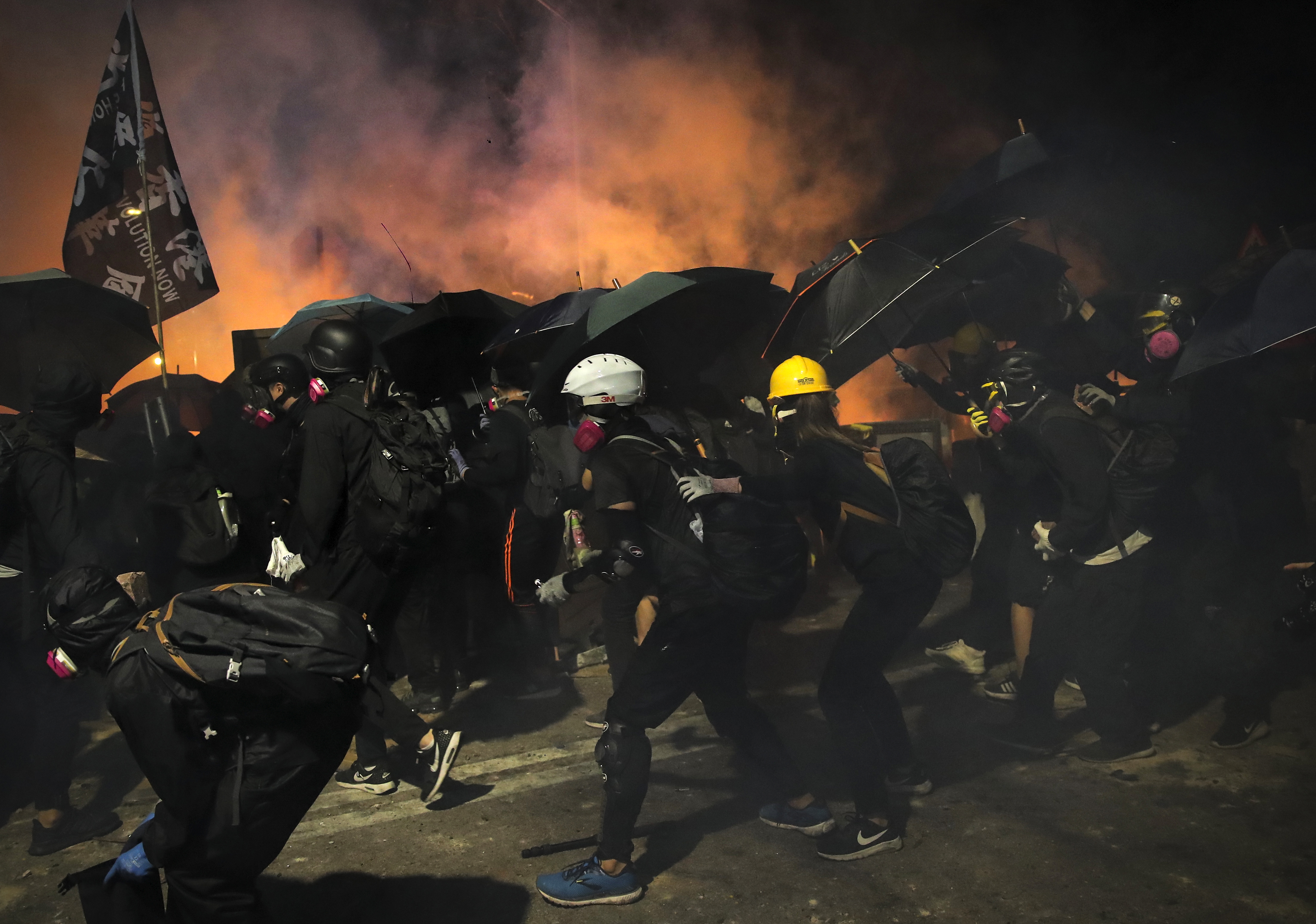 Students use umbrellas as a shields during a clash with police at the Chinese University in Hong Kong, on November 12, 2019