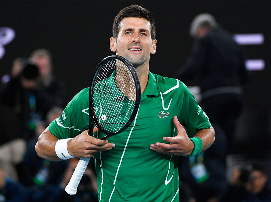 Novak Djokovic celebrates after defeating Canada's Milos Raonic during their quarterfinal match at the Australian Open tennis championship in Melbourne on Tuesday