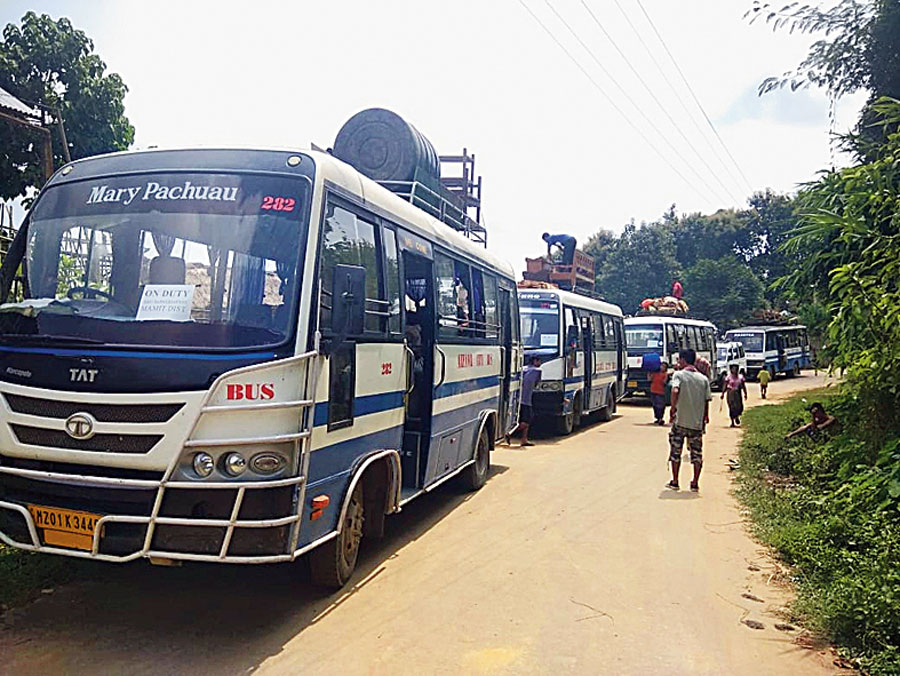 Buses wait for Bru families near Khakchang relief camp in North Tripura on Wednesday