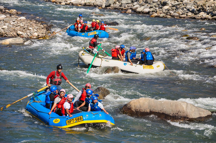 Tourists raft at the Beas River near Manali on Wednesday