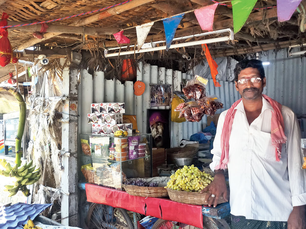 Fruit seller P. Pornaiah at his kiosk fitted with CCTV cameras.