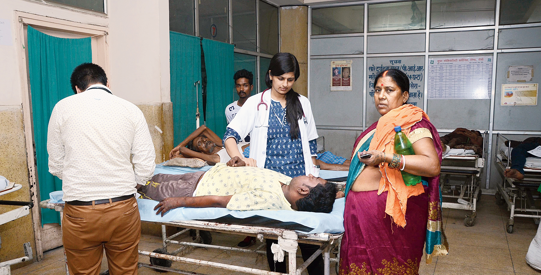 A doctor attends to a patient at the emergency ward of RIMS in Ranchi on Monday.