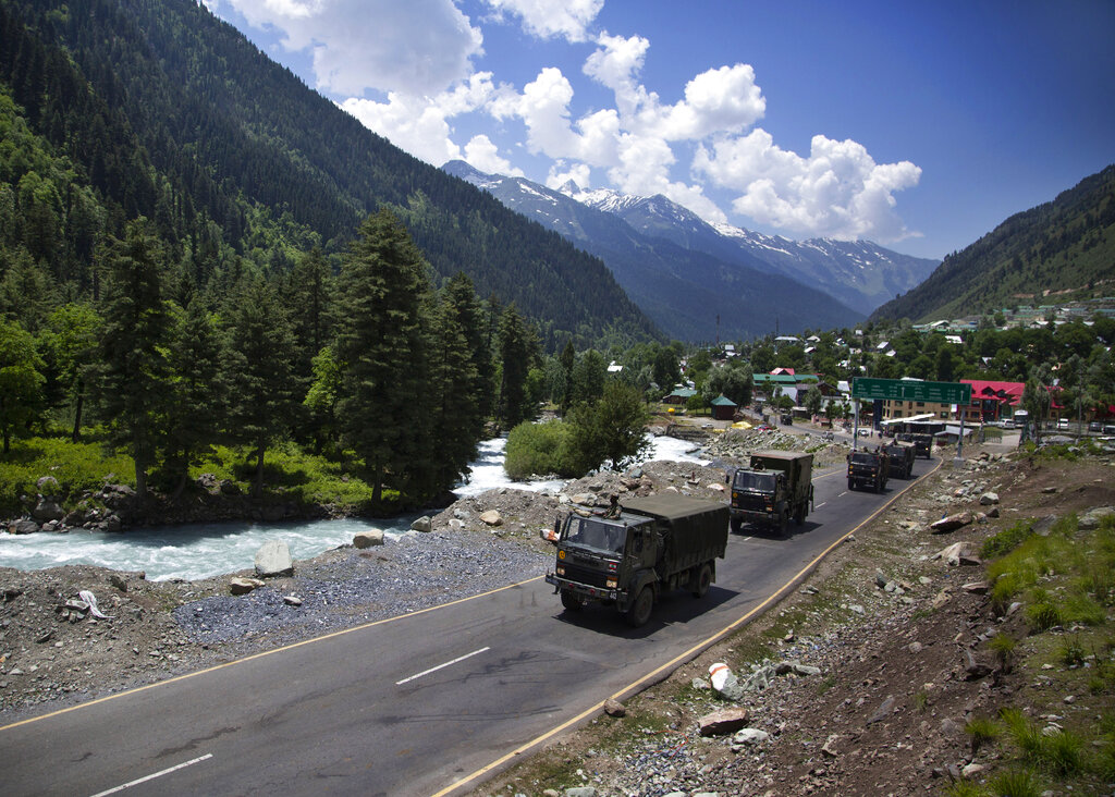 An Indian army convoy moves on the Srinagar-Ladakh highway at Gagangeer, northeast of Srinagar, on Wednesday.